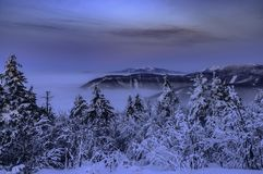 Inverse winter evening mountains in Beskydy. Inverse winter evening from mountain Radhost from Czech Republic royalty free stock photos