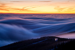 Inversion almost above the ski resort with lift and snow cannon Stock Photo
