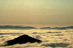 Inversion of the mountains. Morning inversions with wooded mountains Stock Photos