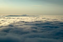 Inversion of the mountains. Morning inversions with wooded mountains Stock Images