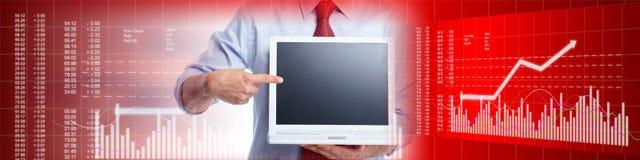 Inversor con el ordenador portátil Fotografía de archivo