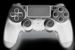 Invert color of DualShock Wireless Controller for PlayStation 4, video game controller analog, popular manual joystick on black bg. Invert color of DualShock royalty free stock photos