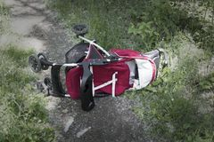 Inverted baby carriage rests on a forest road, kidnapping a child, stealing children stock images