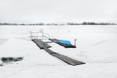 Inverted boat on the pier with snow river. Boat on the pier with snow river Stock Photos
