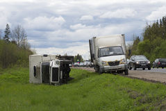 Inverted cargo van-refrigerated truck lies in a ditch Stock Image