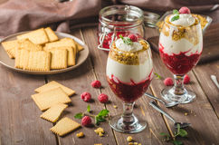 Inverted cheesecake dessert in glass. Delicious and simple with fresh fruits and biscuit with light creame royalty free stock image
