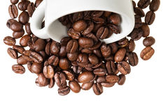 Inverted coffe cup with beans Royalty Free Stock Image
