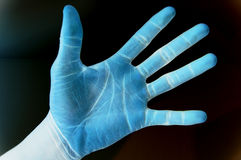 Inverted colour black hand. This is an image of inverted coloured black hand, with a hint of blended background stock image