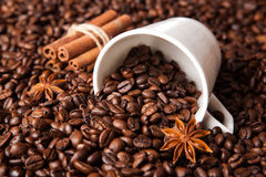 Inverted cup with coffee beans Royalty Free Stock Photo