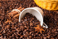 Inverted cup with coffee beans Stock Images