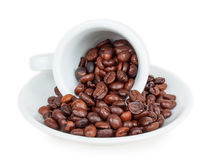 Inverted cup with coffee beans Royalty Free Stock Images