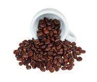 Inverted cup with coffee beans Stock Photo