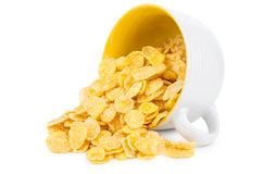 Inverted cup with corn flakes  on white Stock Photography