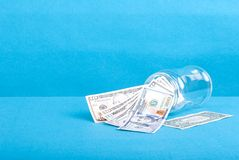 The inverted glass jar with dollar bills, side view Royalty Free Stock Photos