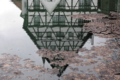 Inverted house in puddle Stock Image