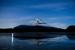 Inverted image of Mt.Fuji on the frozen lake Royalty Free Stock Photo