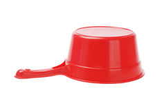 Inverted Plastic Scoop. Inverted Red Plastic Scoop On White Background royalty free stock photo