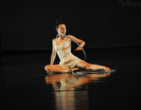 Inverted reflection -Dance musical:Red line. In May 22nd, the French original dance musical red line at the Jiangxi Art Center held. Chinese youth dance actor Stock Photo