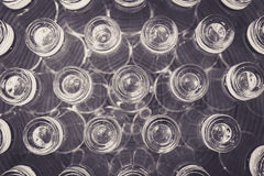 Inverted shot glasses on a plate background. Edited matte b&w Stock Photo