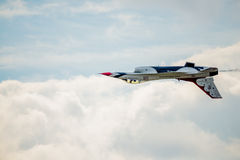 Inverted Thunderbird over the Clouds royalty free stock photography