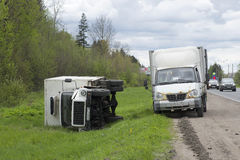 Inverted truck lies on the side of the highway. Leningrad region Royalty Free Stock Images