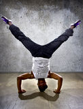 Inverted Urban Break Dancer. Inverted black breakdancer doing a headstand or handstand or urban yoga Royalty Free Stock Photos