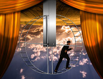 Inverted world and man. High Resolution 3D Illustration Inverted world and man on hamster wheel Stock Photography