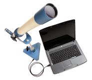 Inverting telescope with laptop. Royalty Free Stock Photo