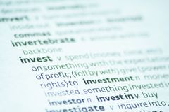 Invest. Close up of the dictionary definition of invest Royalty Free Stock Photo