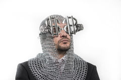 Invest, businessman with medieval executioner in metal and silve Stock Photos