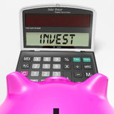 Invest Calculator Shows Deposit In Growing Savings Royalty Free Stock Photos