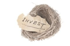 Invest concept. Word in bird nest Stock Image