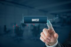 Invest. Concept. or trader click on button with text . Tradeview graph on background stock photo