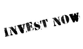 Invest now stamp. Grunge design with dust scratches. Effects can be easily removed for a clean, crisp look. Color is easily changed Stock Photo