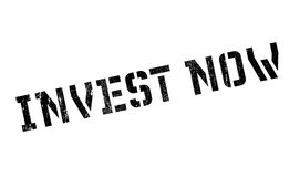 Invest now stamp. Grunge design with dust scratches. Effects can be easily removed for a clean, crisp look. Color is easily changed Royalty Free Stock Image
