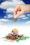 Invest in real estate. Invest in real estate concept. House money and hand royalty free stock photos