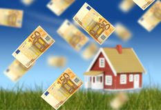 Invest in real estate. Concept of home ownership. Euro money falling from sky. New house on the background Stock Photography