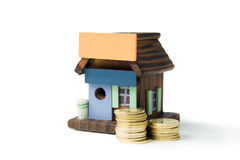 Invest in real estate concept. Using miniature house and gold coins Royalty Free Stock Photo