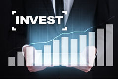 Invest. Return on investment. Financial growth. Technology and business concept. Invest. Return on investment. Financial growth. Technology and business concept Stock Photos
