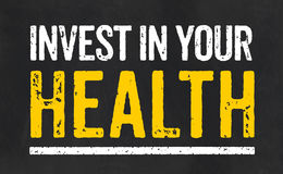 Invest in your health. Blackboard with the text Invest in your health Royalty Free Stock Images