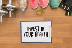 Invest in your health Healthy lifestyle concept with diet and fi Royalty Free Stock Images