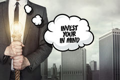 Invest your in mind text on speech bubble with businessman Stock Photo