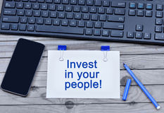 Invest in your people words on paper Royalty Free Stock Photos