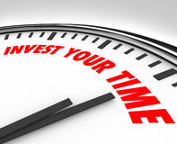 Invest Your Time Clock Priorities Opportunities Resources. Invest Your Time words on clock face suggesting you devote energy and resources to a job, project Royalty Free Stock Photo