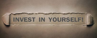 Invest in yourself word on torn paper. royalty free stock photo