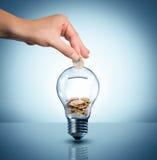 Investa al concetto di energia - euro in lampadina fotografia stock