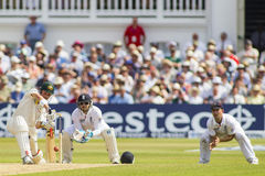 The Investec Ashes First Test Match Day Four. NOTTINGHAM, ENGLAND - July 13, 2013: Ed Cowan hits the balland is caught by Jonathan Trott during day four of the royalty free stock images