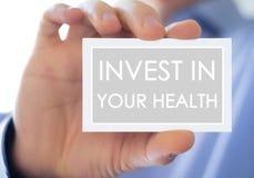 Investeer in uw gezondheid stock foto