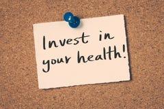 Investeer in uw gezondheid stock afbeeldingen