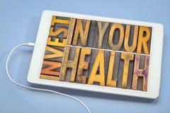 Investeer in uw gezondheidsconcept stock foto